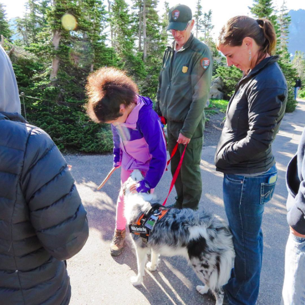Natioanl Bark Ranger Gracie and park visitors